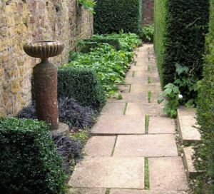 Try dramatic decorative features in your side garden