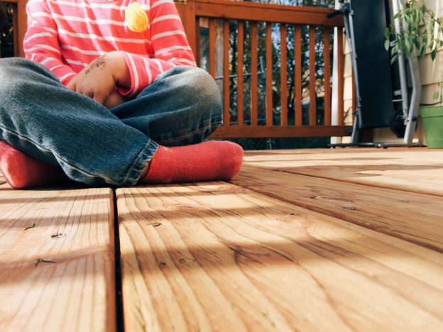 Boy Sitting on Decking | eDecks