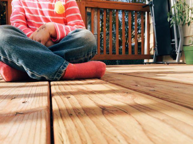 Boy Sitting on Decking | eDecks